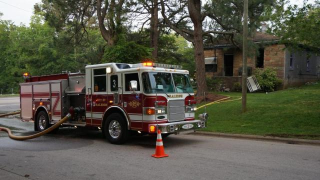 Authorities shut down a segment of Martin Luther King Jr. Boulevard Monday morning after a home caught fire.