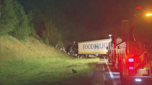 A family of four survived because they were out of their car when a tractor-trailer plowed into it Saturday night.