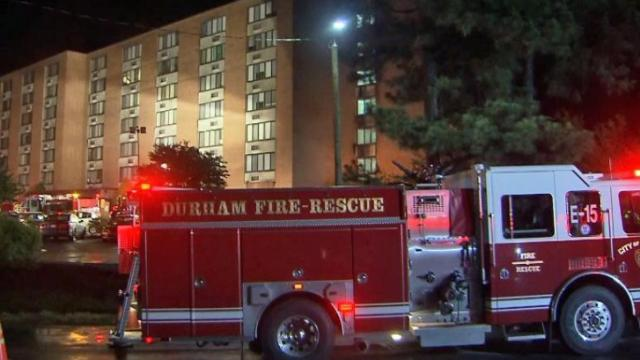Four people were taken to the hospital and a firefighter was treated for dehydration early Monday after fire damaged part of the fifth floor of JFK Towers on North Roxboro Road, fire officials said.