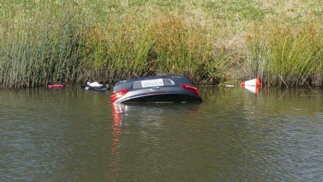 One man was rescued from a car sinking in an Apex pond Monday.