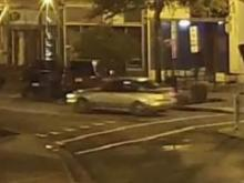 Police are searching for a suspect vehicle after a woman said she was shot in the shoulder on July 7 by a pellet gun while standing outside of a Fayetteville pub.