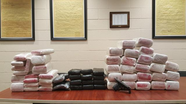 Sheriff's deputies jailed four men in Orange County on Friday after finding more than 80 kilos of what is suspected to be cocaine.