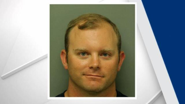Officers arrested Joseph Robert John, a coach from Wake Forest's Heritage High School, late Saturday.