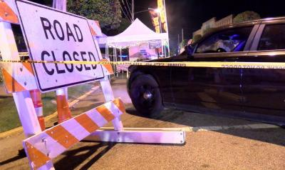 A driver injured three people early Saturday morning when he plowed through a barricade at the Clayton Harvest and Music Festival.