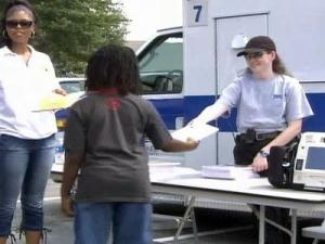 Members of Vision International Church in Raleigh hand out free school supplies on Aug. 2, 2008.