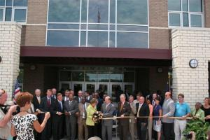 Sen. Elizabeth Dole (yellow jacket, center) cut the ribbon opening the new Clinton high school Aug. 14, 2008.