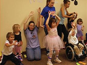 Children in the Adaptive Dance & Movement class practice for a dance recital at the Therapy Services Department of Raleigh Neurology Associates. The first-ever recital is part of the children's therapy for neurological disabilities. (Photo courtesy of Raleigh Neurological Associates)