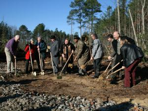 Members of the Chatham County Board of Education and the Chatham County Board of Commissioners dipped their shovels in the dirt Thursday to break ground for a new middle school in the Briar Chapel development.