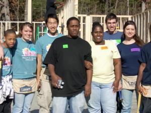 Ann McRae and her son, Quartez, 17, (center) stand with youth volunteers on the first day of construction of a Habitat for Humanity house in east Durham. When it's completed, McRae, Quartez and Carlessia, 10, will live in Hope Crossing, the first green, affordable-housing community in North Carolina. (Photo courtesy of Habitat for Humanity of Durham)