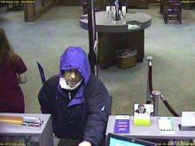 The man in these surveillance photos is a suspect in a bank robbery.