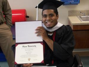 Edgar Huff shows off his diploma from Shaw University after a graduation ceremony held at Pitt Memorial Hospital on Friday, May 22, 2009. Huff, a baseball star and holder of a 3.6 GPA, was seriously injured in a wreck with an alleged drunken driver on May 5, 2009, four days before the college's commencement exercises. (Photo courtesy of Shaw University)