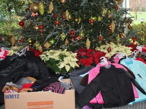 Staff and inmates from the Wake Correctional Center donated more than $1,000 in coats, hats and gloves to the WRAL Coats for the Children campaign Wednesday.