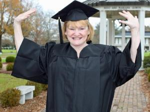 Brenda Robbins, 63, of Rocky Mount celebrates her graduation from Mount Olive College on Saturday, Dec. 12, 2009. (Photo courtesy of Mount Olive College)