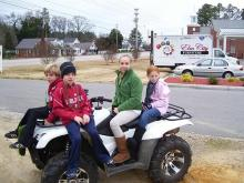 Children watch the New Hope Christmas Parade on Friday, Dec. 25, 2009, on N.C. Highway 58. (Photo courtesy of Bobby Vick)