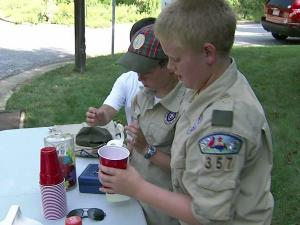 Three Boy Scouts set up a lemonade stand Monday on Blenheim Drive and Downs Court in Raleigh to raise money for an injured man.