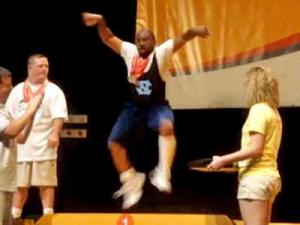 A Special Olympics athlete Charles Quick from Durham celebrates his gold medal win by dancing on the podium. (Photo courtesy of YouTube)