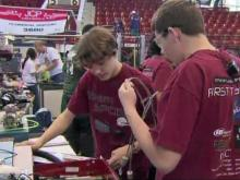 Two thousand high school students from across the state converged on Raleigh's Dorton Arena Friday to see whether their creations would come alive under pressure of competition. The 52 teams were entrants in the 2011 NC FIRST Robotics Competition.