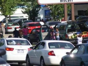Members of Greater Joy International Ministries, 2000 Chapel Hill Road, gave away about $6,000 worth of gas to between 300 and 400 drivers at the Lakewood BP, 218 W. Lake Ave., and Tri-Star Mobile, 2900 Chapel Hill Blvd., on Saturday, July 16, 2011. (Photo courtesy of Greater Joy International Ministries)