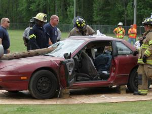 Representatives of the Vance County fire and EMS departments staged a mock crash Tuesday morning at Kerr-Vance Academy in Henderson to bring home the reality of risky driving.