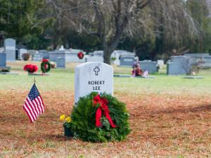 Volunteers at Oakwood Cemetery in Raleigh decorated 33 graves of military veterans Saturday with holiday wreaths, part of the national Wreaths Across America effort. (Photos by Brent Mathison)