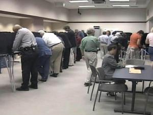 People cast ballots in the Wake County Board of Elections office on Oct. 16, 2008, the first day of early voting for the November election.