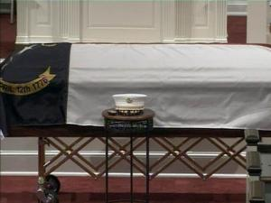 A fire marshal's hat sits next to the flag-draped casket of former state Insurance Commissioner Jim Long during a Feb. 5, 2009, memorial service in Raleigh.