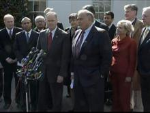 Gov. Beverly Perdue, in red, was among several governors to meet with President Obama Monday to discuss plans for the federal stimulus.