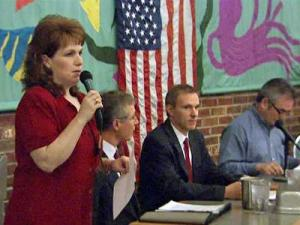 Heather Johnson, of Chatham Conservative Voice, hosts a forum on Chatham County's illegal immigration policy on Feb. 26, 2009. Commissioners did not attend the meeting for concerns for their safety.