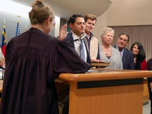 Chapel Hill mayor Mark Kleinschmidt takes the oath of office Monday evening.