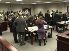 Cuts will likely make lines at courthouses longer