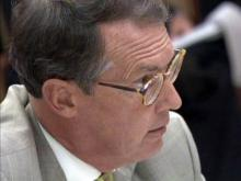 N.C. Republican Party Chairman Tom Fetzer challenges the investigation of campaign flights taken by Gov. Beverly Perdue during an Aug. 24, 2010, meeting of the State Board of Elections.
