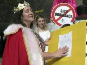 Costume shop owner Louie Bowen obtained a panhandling permit to get around Raleigh's regulations for business advertising, which she says are too restrictive.