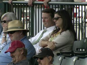 John Edwards and his daughter Cate watch a game at the 2012 Atlantic Coast Conference Baseball Championship in Greensboro on May 23, 2012, while waiting for a jury verdict in Edwards' campaign finance case.