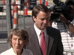 John Edwards and his mother, Bobbie, walk past news photographers on May 25, 2012, on their way into the federal courthouse in Greensboro, where he awaits a jury verdict in his campaign finance trial.
