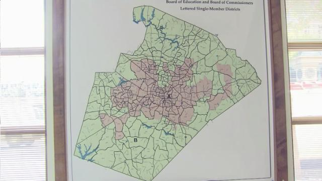 A federal appeals court has ruled two regional voting districts for Wake County school board and commissioners unconstitutional, ruling too many voters were packed into the pink urban district and not enough were included in the green district ringing the county's edges.