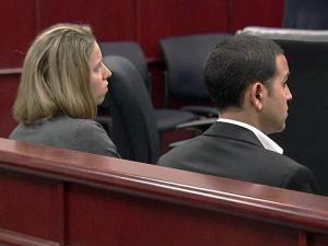 The owners of A1A Locksmiths sit in a Wake County courtroom on June 29, 2010.