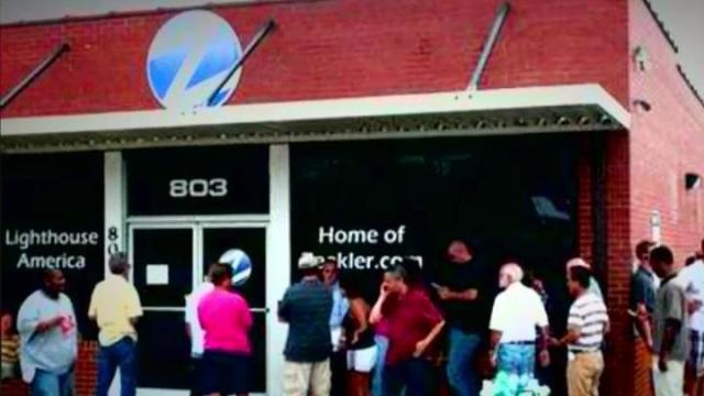 People lined up outside ZeekRewards in Lexington