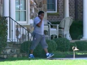 Eric Leak talks on the phone while state agents search his Raleigh townhouse.