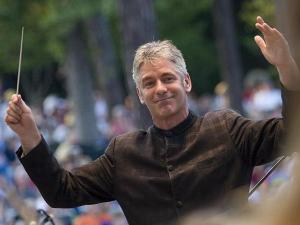 Music Director Grant Llewellyn conducts the North Carolina Symphony during their Independence Day performance.