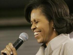 Michelle Obama, wife of Democratic presidential hopeful, Sen. Barack Obama, D-Ill., reacts as the crowd sings Happy Birthday to her, on her birthday, at a town hall meeting in Las Vegas, Thursday, Jan. 17, 2008. (AP Photo/Charles Rex Arbogast)