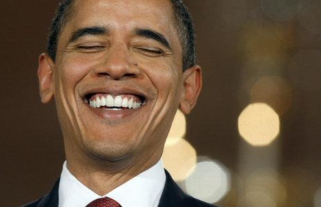 MONDAY: President Barack Obama laughs during his first prime-time, televised news conference in the East Room of the White House in Washington. (AP Photo/Charles Dharapak)