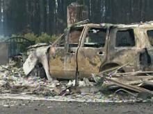Residents escape wildfires, but homes don't