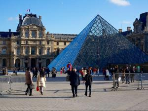 Locals and tourists work to regain a sense of normalcy following the terrorist attacks in Paris on Nov. 13, 2015.