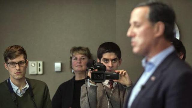 Elon University student Gary Grumbach records a campaign stop by Republican presidential candidate Rick Santorum in Iowa.