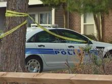 Police serving warrants near UNC-Charlotte on Tuesday shot and killed a man with a gun.