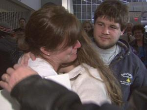 Kellee Metty was greeted at Raleigh-Durham International Airport Saturday with hugs and tears. She had been in Haiti when an earthquake struck the country.