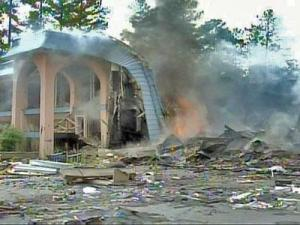 An abandoned motel in Durham continued to burn on July 16. Investigators said that the fire is most likely arson.
