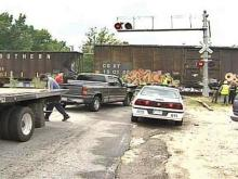 Police clean-up an accident between a truck and train at a crossing in Garner on Friday, September 14.