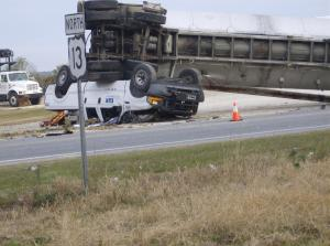 A crew-cab pickup was crushed under the back end of the overturned tanker on U.S. Highway 13 near Newton Grove.