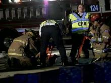 Rescue workers help victims of a vehicle accident Saturday night on Interstate 40 westbound.